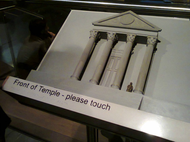 Temple Front Display - the notice makes a nice change from museums when I was growing up. At the Baths, you are encouraged to touch the exhibits!