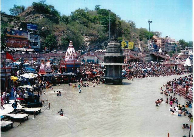 Devotees dipping in the Ganges in their quest for absolution