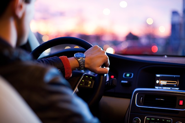 unsplash image of a driver. Image via Pixabay.