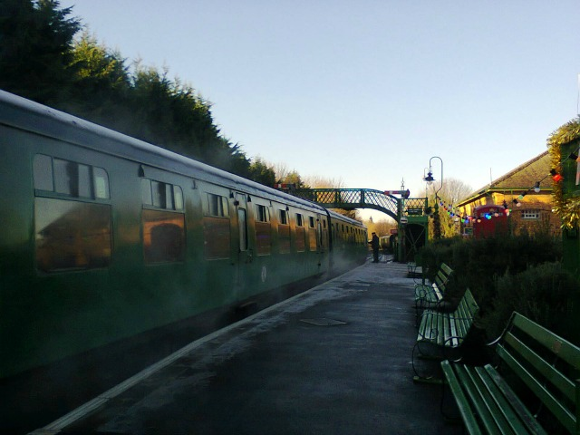 The steam train now standing at...