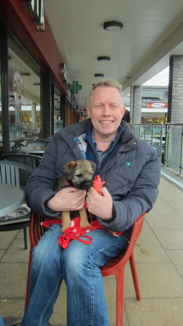 Dom Hooley, joint manager of Eastleigh Basics Bank, with his new puppy, Moose.