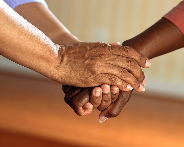clasped hands skeeze image via Pixabay