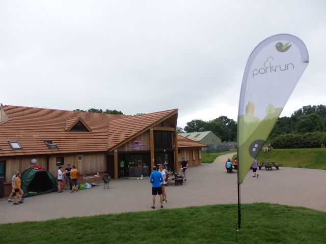 parkrun banner at pavillion in the park