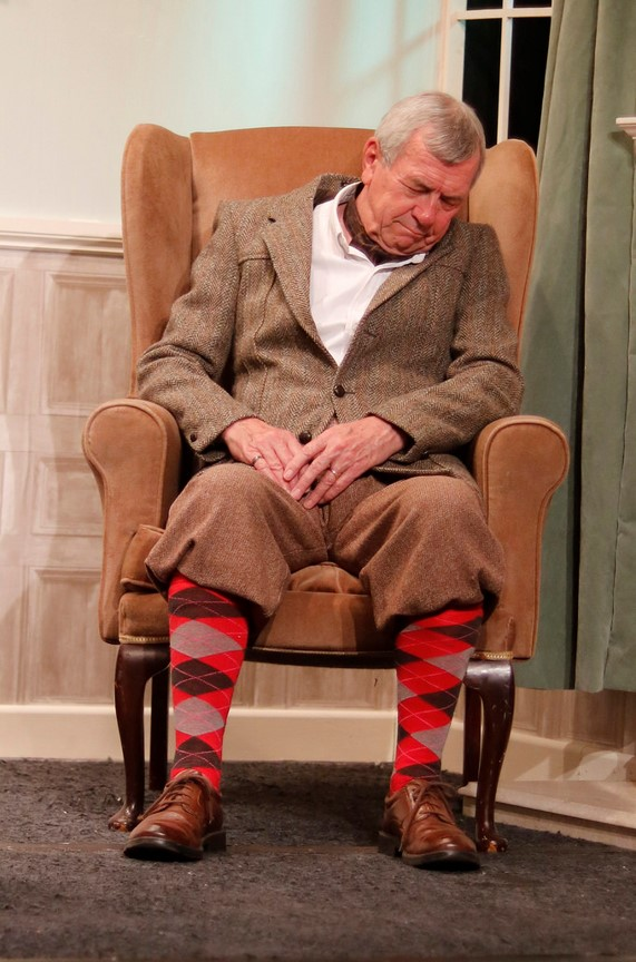 Colonel Craddock enjoys the only moments of peace in the play