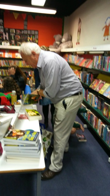 Richard signing both of his books for a fan. One week at Eastleigh Library as here, another week at the Book Fair.