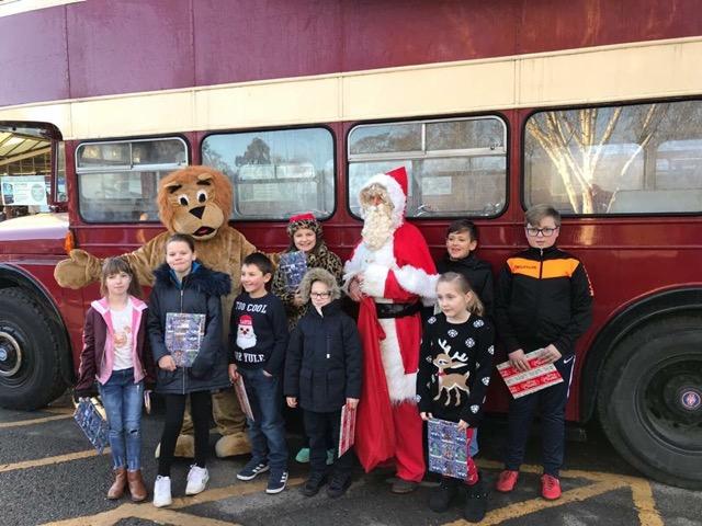 Brambridge Garden Centre - Santa, Eastleigh Lions, and happy children.