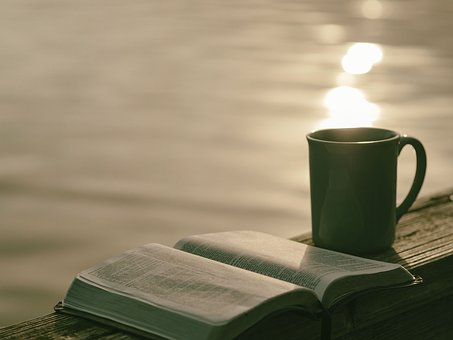 A great way to relax - with a book and a cuppa - image via Pixabay
