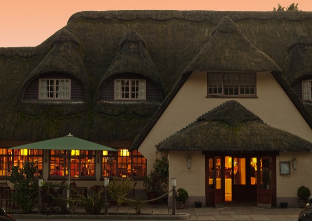 The thatched Potters Heron hotel in Ampfield, Hampshire. Image by Anguskirk via Flickr. 2.0 Generic (CC BY-NC-ND 2.0).