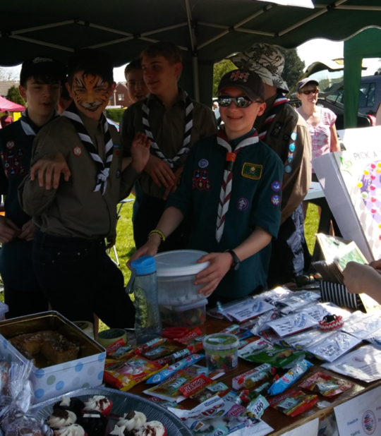 The Scouts working hard at their stall though there had been time to visit the face painting stall too
