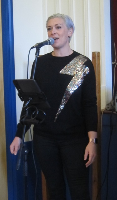 Singer Emily Blackledge singing live at the Christmas Market in Chandler's Ford.