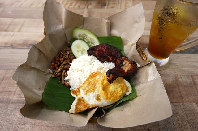 Nasi Lemak is a typical Malaysian dish. Nasi Lemak Malaysian food via multifacetedgirl Pixabay