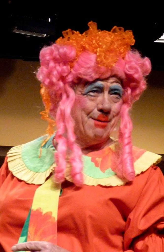 Told you the hair had to be seen to be believed but this is the classic pantomime dame look
