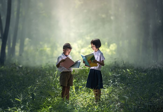What every children's writer wants to see - young people engrossed in books - Pixabay image