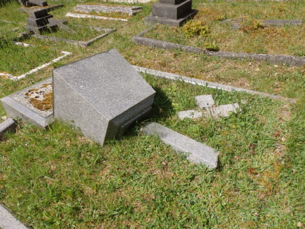 Pine Road Cemetery monument laid to the ground