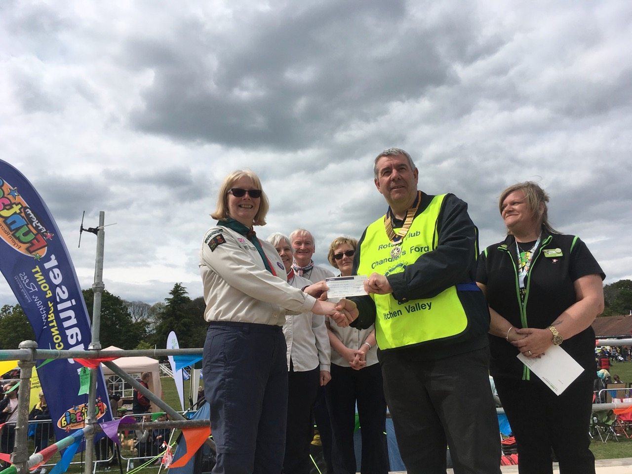 President of Rotary Ed Burt handing over the cheque for £3000 raised by Rotary for Chandler's Ford 15th, to Susan Deeks, group Scout Leader for the 15th Scout Group.