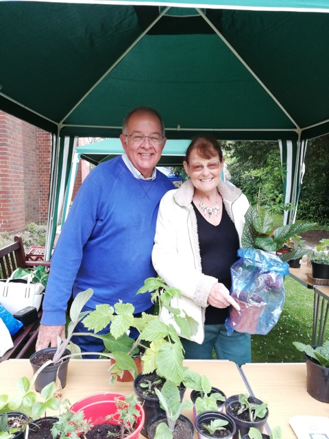 Duncan and Hazel selling plants outside (still smiling at 11am)