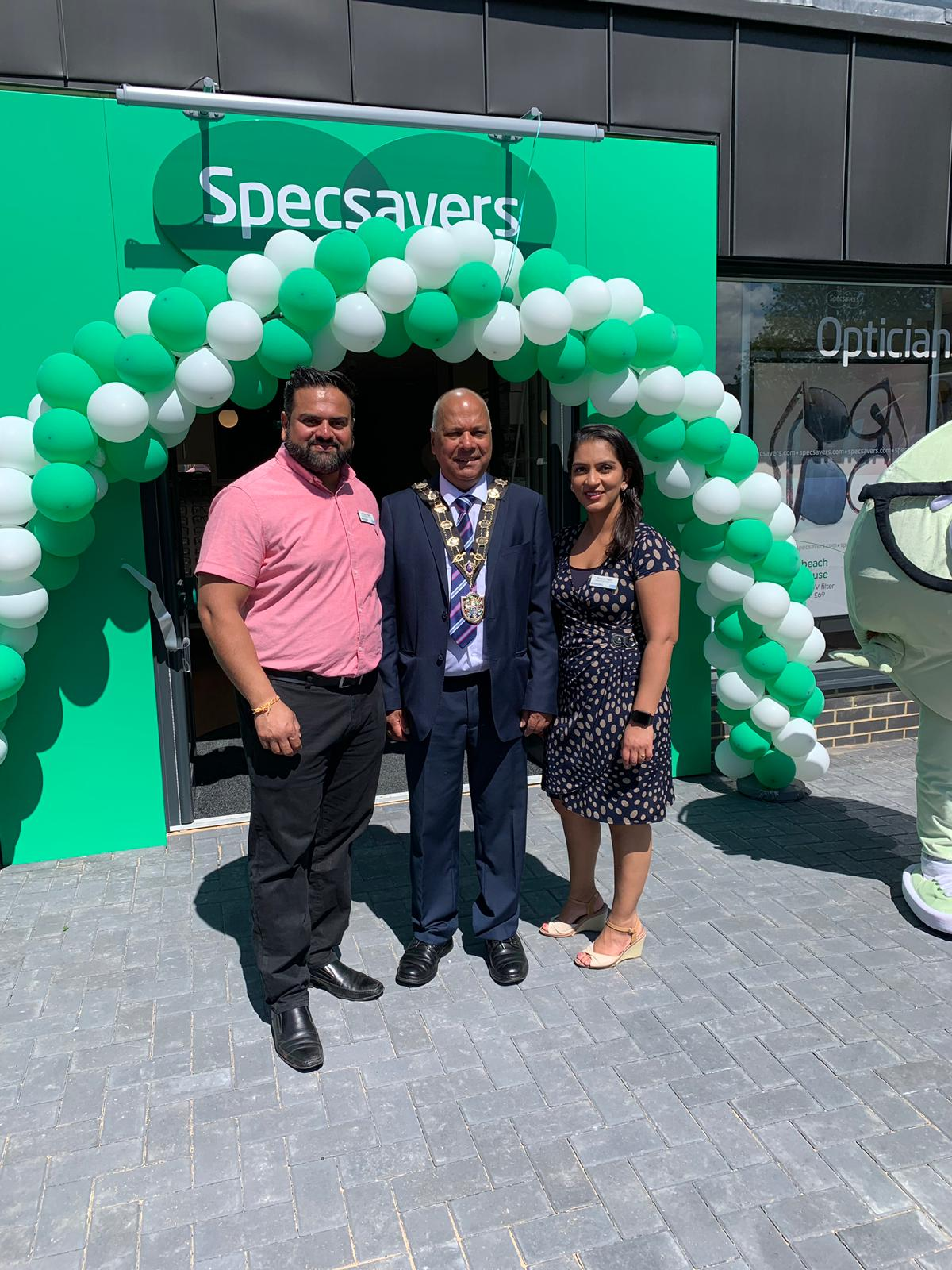 Pharmacists Mitesh and Bhavini Patel and Mayor of Eastleigh Cllr Darshan Mann at the new Specsavers branch in Chandler's Ford