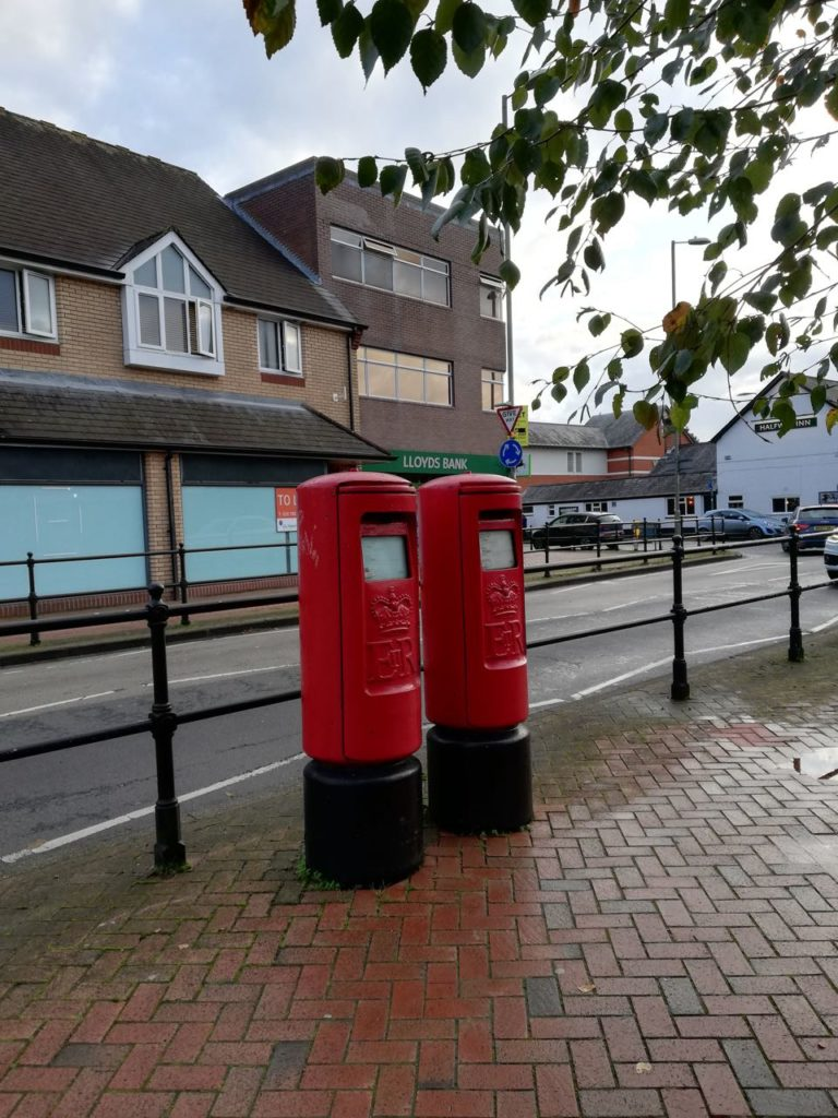 Two pillar boxes (clearly not phone boxes!) but no post office.