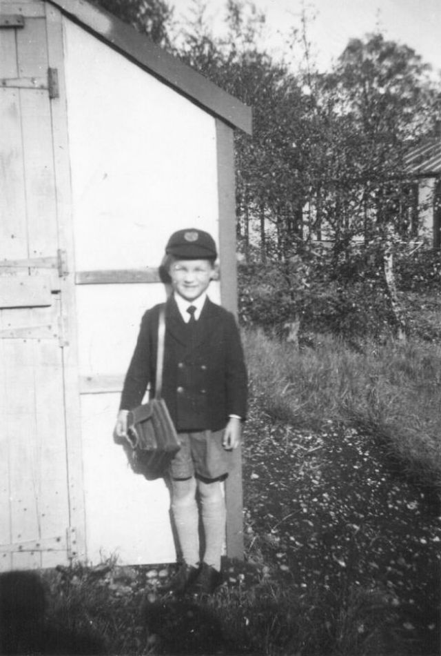 PHOTO 10 - Peter by the garden shed at No. 42 ready to catch the bus on Hursley Road to go to Hursley Primary in May 1955