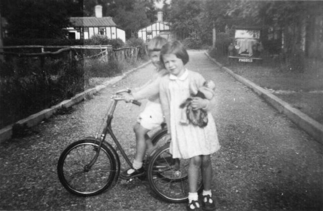 PHOTO 21 - Peter with Janet Evans in the southern service road in Summer 1953 looking eastwards towards Hursley Road