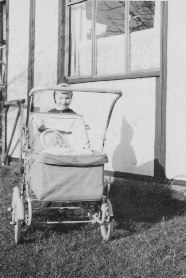 PHOTO 22 - Peter with Alan Davies (in the pram). Alan with parents, Eiddig (Taff) and Audrey Davies lived at Hutment No. 96