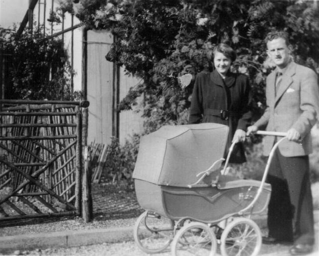 PHOTO 7 - Ruth and Jack Russell with Peter in the pram aged about one month - July 1950