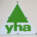 the new YHA logo – updated, but still the friendly green triangle. (Picture credit: underclasscameraman via Flickr.com)