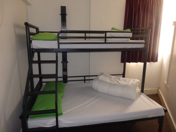 This room, in a London youth hostel, slept three, on a double bed with a single bunk above